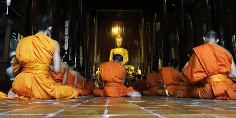 monks praying in temple,chiang mai , Thailand