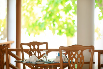 Table set in modern cafe at resort