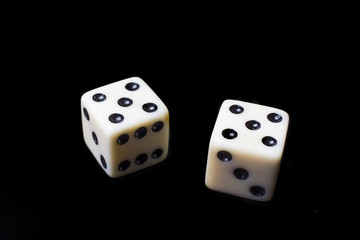 Dice on a black background - selective focus