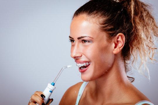 Brushing Teeth With Water Flosser