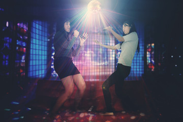 Two women singing in the nightclub