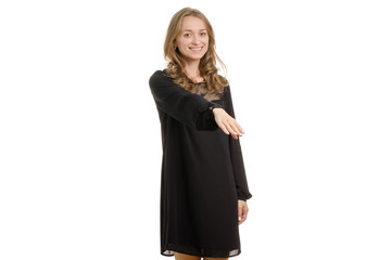 Girl in black dress extends her hand to say hello