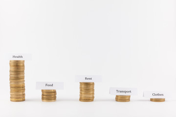Big expenses on health. Coin stacks isolated in white background with labels