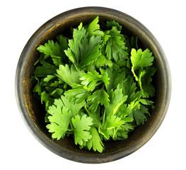 Fototapeta Top view of fresh parsley leaves in bowl on white background obraz