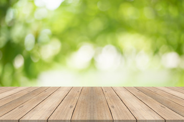 Empty wood table top on blurred abstract green background,Free space for editing products.