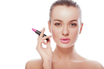 Close up beauty portrait of young woman with clean fresh perfect skin and nude makeup look at camera and holding lipstick like a cigarette. Spa, cosmetics, surgery, fashion concepts. Skin treatment.