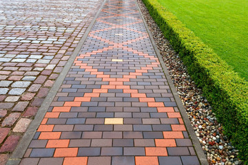 Beautiful pavement of red and brown clinker brick. Walking path