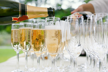 many of the champagne glasses on a buffet table. party in open air