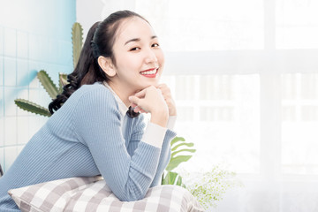 beautiful Asian women sit in living room with happy time
