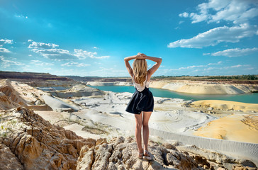 Girl on the background of quartz sand quarry Wall mural