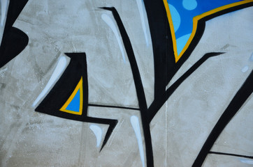 The old wall, painted in color graffiti drawing silver chrome aerosol paints. Background image on...