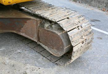 Part of hydraulic backhoe machine at bridge construction site.