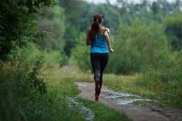 Running girl in summer woods