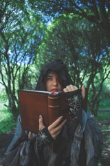 Image of witch with book