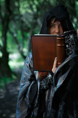 Young witch with magic book