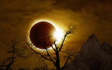 Total solar eclipse in dark glowing sky