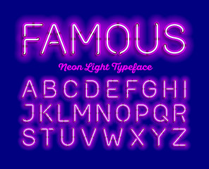 Famous, neon light typeface. Purple modern neon tube glow font