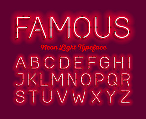 Famous, neon light typeface. Red modern neon tube glow font