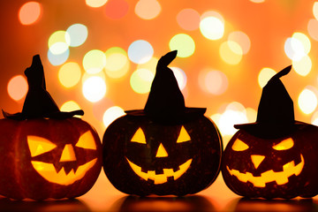 Three scary pumpkins with hats