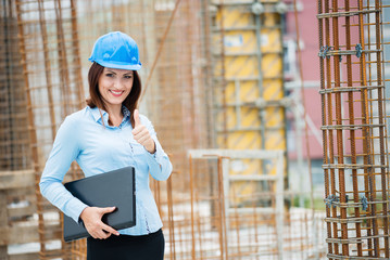 Architect or construction worker smiling at camera on construction site.Copy space