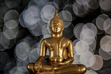 Amazing golden buddha with bokeh background, symbol of peace, meditation and  enlightenment