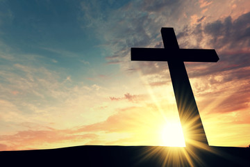 Religious cross silhouette against a bight sunrise sky. 3D Rendering