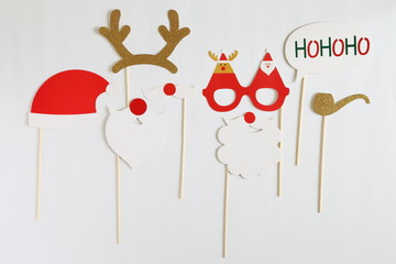 Photo booth colorful props for christmas party - mustache, santa claus, pipe, hat on white background