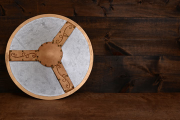 warrior shield leaning on wood wall