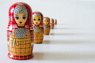 Five red matryoshka. Long shadows