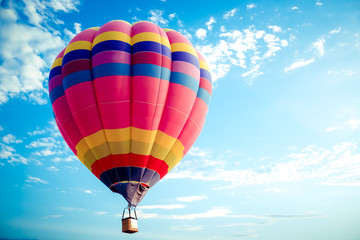 Poster Ballon Colorful hot air balloon flying on sky. travel and air transportation concept - balloon carnival in Thailand
