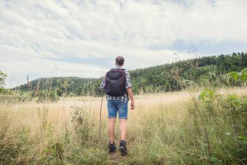 Young hiker in nature / wilderness - trekking outdoors.