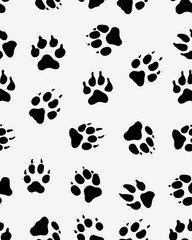 Seamless pattern of black silhouettes of prints of dog paw