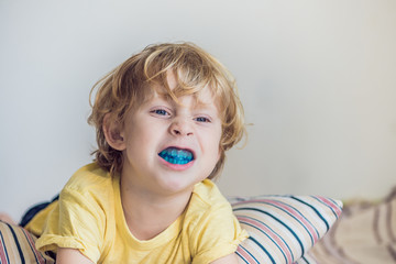 Three-year old boy shows myofunctional trainer to illuminate mouth breathing habit. Helps equalize the growing teeth and correct bite. Corrects the position of the tongue