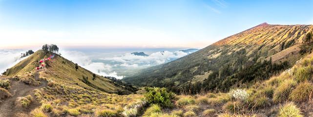 Panorama mountain view above the cloud and blue sky. Rinjani mountain, Lombok island, Indonesia.