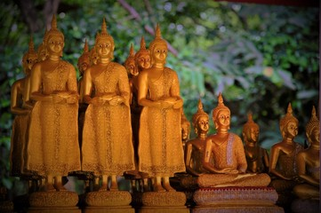 Low light mode for raw of Gold Buddha Statues in Thailand, Asia