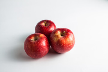 close-up view of fresh red apples on a white background