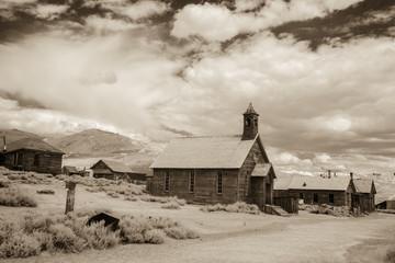 Methodist church on streets in Bodie, California in b&w
