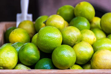Many Fresh Green Yellow Lime on Wooden Bucket , Lime Harvest,
