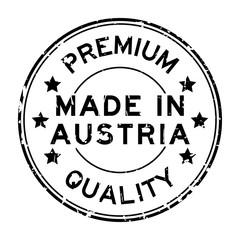 Grunge black premium quality made in Austria round rubber seal stamp on white background