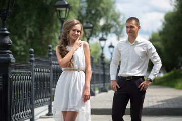A love couple, husband and wife, models stroll on a summer day. Relations, love, family values, wedding.