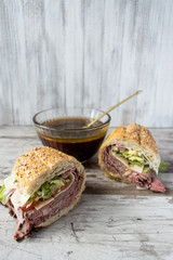 roastbeef sandwich with bowl of beef broth for dipping