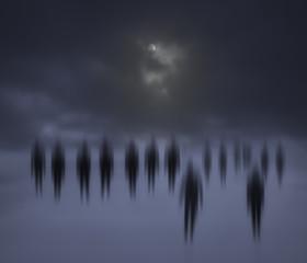 Blurred people walking at night