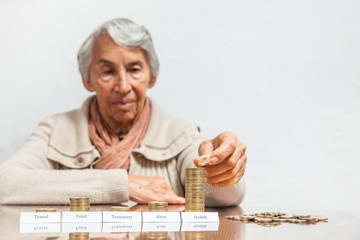 Senior woman budget with big expenses on health