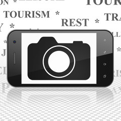 Travel concept: Smartphone with Photo Camera on display