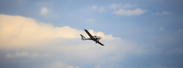 Small plane on blue sky background