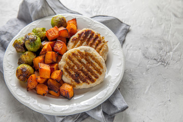 Aluminium Prints Brussels Diet food. Grilled chicken cutlets, roasted sweet potato and brussel sprout