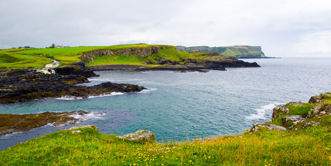 Panorama of Dunseverick Falls. Landscape of Northern Ireland.
