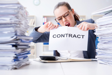 Businesswoman tearing apart her contract