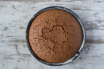 baked brown cake layer in pan in rustic setting