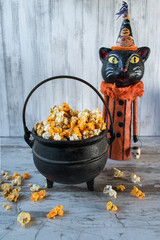 Halloween popcorn in cauldron with cat